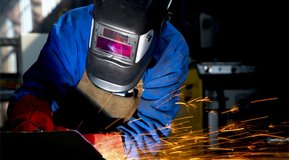 Man welding wearing protective mask